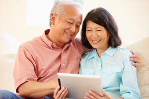 "ALT=""senior couple on sofa reading, disability insurance waiver""ead Insurance Mail"""